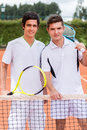 Male tennis players looking happy at a clay court Stock Photography