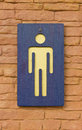 Male toilet sign on the brick wall Royalty Free Stock Photo