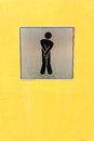 Male toilet sign on yellow wall Stock Images