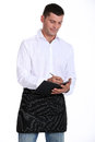 Male waiter taking order Royalty Free Stock Photo