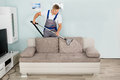 Male Worker Cleaning Sofa With...