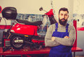 Male worker demonstrating motorbikes and scooters Royalty Free Stock Photo