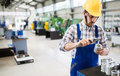 Male worker and quality control inspection in factory Royalty Free Stock Photo