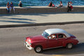 Malecon boulevard shoreline havana cuba february classic old american car in the streets of havana classic cars are still in use Royalty Free Stock Photo