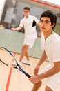 Males playing squash male players a match of Royalty Free Stock Photo