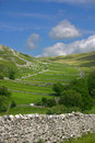 Malham dale scenery and limestone escarpment in north yorkshire dales england Royalty Free Stock Images