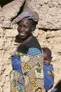 Malinese woman carries her child Royalty Free Stock Photo
