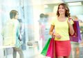 Mall admirer young woman admiring shop windows Royalty Free Stock Photos