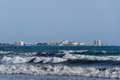 Mallorca coast with big sea waves mediterranean and the city in the background Royalty Free Stock Images