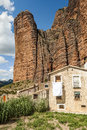 Mallos de riglos with house view of the is a cloudy day it is located in the spanish province of huesca along the pyrenees you can Stock Images