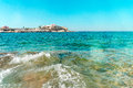 stock image of  Malta Dragonara Casino from Sea blue sky clear water