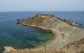 Malta nature, cliffs in malta, Ramla Bay in Malta, maltese landscape with the hill and different blue colour sea on sunny day, sce Royalty Free Stock Photo