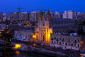 Maltese cityscape evening with neo gothic carmelite parish church in balluta bay st julian s island of malta Royalty Free Stock Images