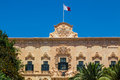 Maltese flag on auberge de castille in valletta malta office of the prime minister of malta Royalty Free Stock Images