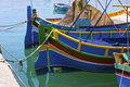 Maltese luzzu traditional fishing boat from malta paintwork on a in Royalty Free Stock Images
