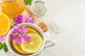 Malva sylvestris, mallow, tea with lemon and flowers Royalty Free Stock Photo