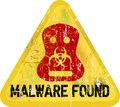 Malware warning computer virus sign grungy style Royalty Free Stock Photos
