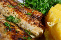 Mamaliga with grilled fish a traditional romanian meal polenta Royalty Free Stock Photos