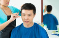 Man�s hair salon close up image of a young men having cutting in the on the foreground Stock Photography