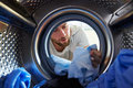 Man Accidentally Dyeing Laundry Inside Washing Machine Royalty Free Stock Photo