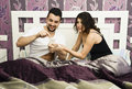Man addicted to social networking dislike the couple in bed Stock Images
