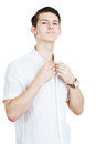 Man adjusting his shirt young on a white background Royalty Free Stock Images