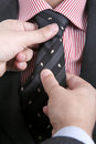 Man adjusting his tie... Royalty Free Stock Photos