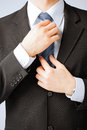 Man adjusting his tie Royalty Free Stock Photo