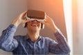 Man adjusting VR goggles Royalty Free Stock Photo