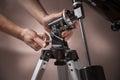 Man adjusts a telescope closeup Royalty Free Stock Photo