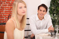 Man admiring blond woman women in restaurant Stock Photos