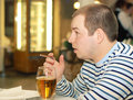 Man adult drink beer and smoke cigarette Royalty Free Stock Photos