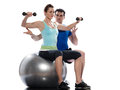 Man aerobic trainer positioning woman  Workout Stock Photo