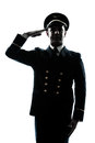 Man in airline pilot uniform silhouette saluting Royalty Free Stock Photo