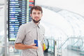 Man in airport holding his pasport and hurrying for his flight Royalty Free Stock Photo