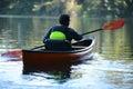 Man alone on a beautiful lake on a kayak Royalty Free Stock Photo