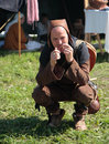 Man in ancient clothes plays the jew s harp vikings camp on aland islands at viking market kvarnbo saltvik Stock Images