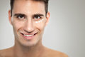 Man with anti aging cream portrait of young skincare Royalty Free Stock Photo