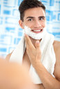 Man applying shaving cream smiling young Stock Images