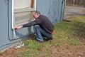 Man applying weather stripping Royalty Free Stock Photo