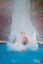 Man at aqua park water sliding Royalty Free Stock Photo