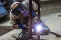 Man arc welding in blue outside Royalty Free Stock Photos