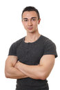 Man with arms folded young muscular or crossed isolated on white Stock Image