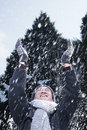 Man with arms raised feeling the snow Stock Images