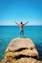 Man with arms wide open on blue tropical sea freedom in Stock Photography