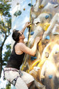 Man on artificial exercise climbing wall Royalty Free Stock Photos