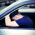 Man asleep in the car toned photo of tired fall a Stock Photos