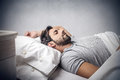 Man asleep a is in his bed Royalty Free Stock Images