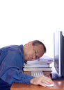 Man asleep his computer keyboard Royalty Free Stock Photography