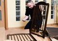 Man assembles a baby crib Stock Photo